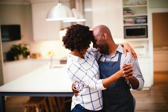 Romantic couple dancing in kitchen