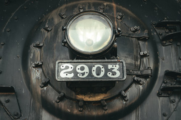 Front of the boiler on an old steam-powered locomotive.