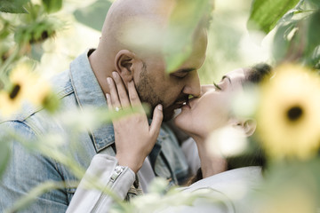 Close up of couple kissing outdoors