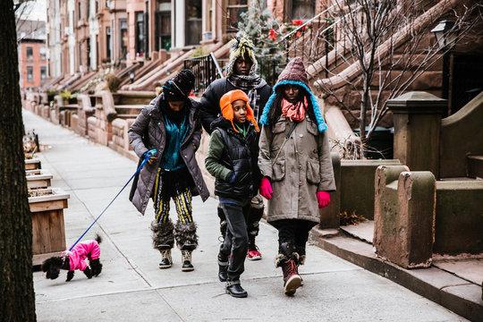 Family walking on sidewalk outdoors