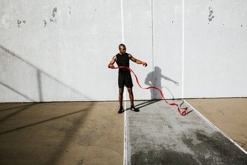 Man holding boxing tape against wall
