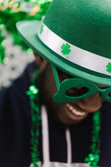 Close up of smiling man wearing green hat and goggles