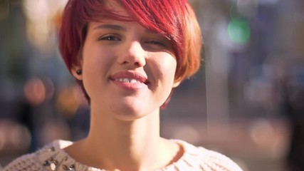 8bb6514250 0 21 Close-up portrait of young caucasian pink-haired girl smiling humbly  into camera on
