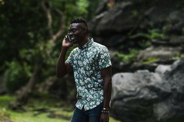 Smiling young man talking on smartphone