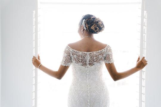 Rear view of bride standing in wedding dress