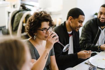 Woman drinking wine in restaurant