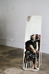 Men reflection in mirror indoors