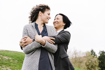 Lesbian couple embracing outdoors