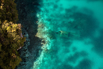 Aerial view of a shipwreck off the rock islands.