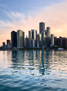 The downtown Chicago IL skyline from Navy Pier at sunset.