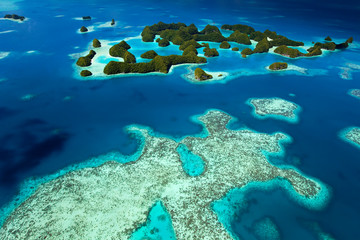 Aerial view of Palau known as 70 Mile Islands as well as the rich coral reef surrounding them.