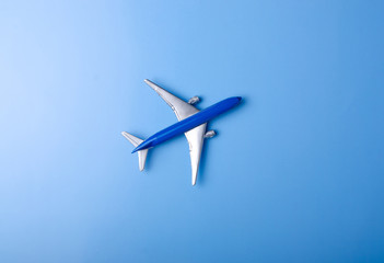 Blue model plane,airplane on color blue background, top view