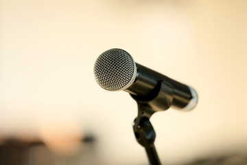 Microphone on abstract blurred hall light