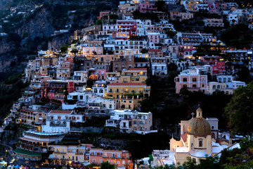 Colorful houses built into the side of a mountain in Positano, Italy.