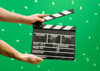 Clapper board on green screen background