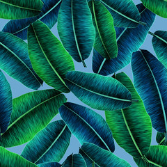 Tropical banana leaves, jungle leaf seamless floral pattern blue background. Artistic palms pattern with seamless repeating design. Pattern for summer designs.