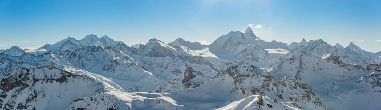 Panorama of the Weisshorn and surrounding mountains in the swiss alps.