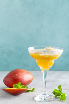 Refreshing summer mango cocktail with fresh juice and ice cream