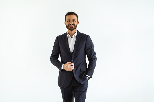 The businessman in a beautiful suit standing on the white background