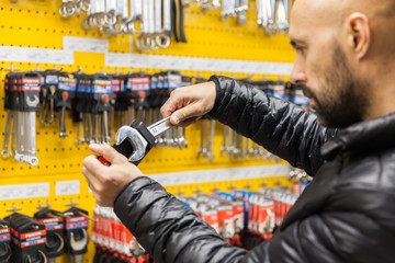 man selects in specialty stores tools and materials