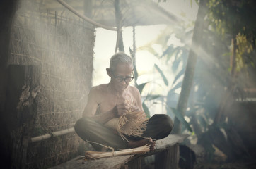 Asia life old man uncle grandfather working in home / asia old man elderly serious living in the countryside of life rural people