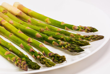 Fresh organic asparagus on a white background