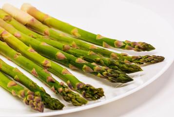 Fresh organic asparagus on a white background