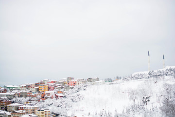 A winter view from the city of Istanbul with houses covered with snow