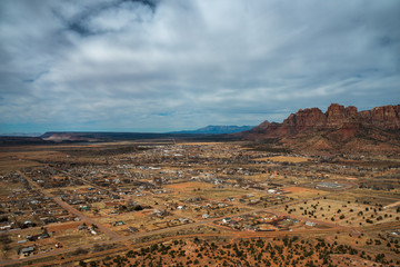Aerial view of desert town on a cloudy day; Hildale and Colorado City, Utah and Arizona State line