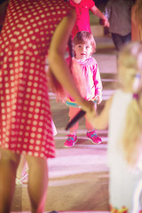 little girl dancing in the kids disco