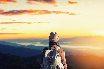Women travelers on the mountain landscape background