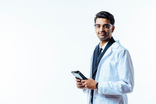 Portrait of a man in business suit, lab coat and protective glasses, holding leather folder, isolated on white studio background