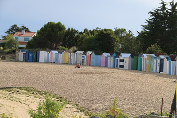 Colourful row of huts on beach
