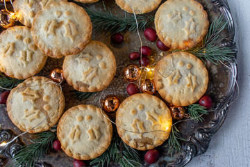 Christmas mince mini pies in festive setting flat lay