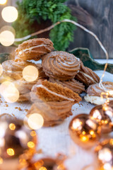 Christmas ginger cream-filled cookies with greenery and bokeh lights