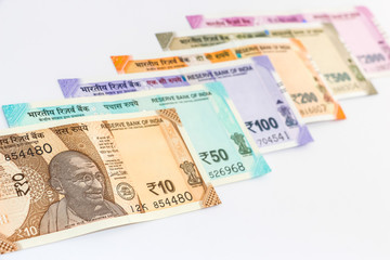 Close up view of brand new indian 10, 50, 100, 200, 500 and 2000 rupees banknotes. Colorful money background.