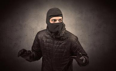 Burglar standing in black clothes and balaclava on his head. - fototapety na wymiar