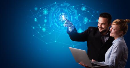 Man touching hologram screen displaying keys and locks