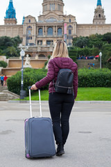 Female tourist with luggage