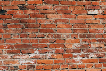 texture of the old brick wall is red