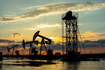 Oil fields in the evening, oil field derrick in the evening,