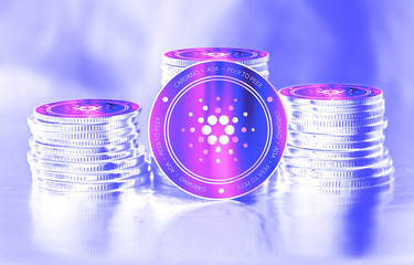 Cardano (ADA) digital crypto currency. Stack of coins. Cyber money.