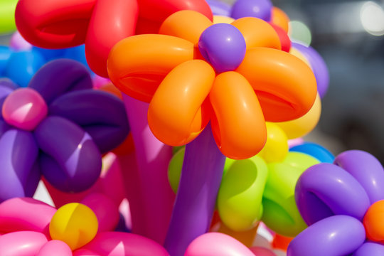 Multicolored flowers from balloons as background