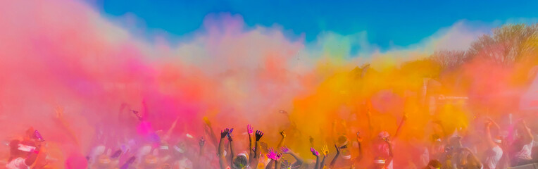 Crowd throwing bright coloured powder paint in the air, Holi Festival Dahan.
