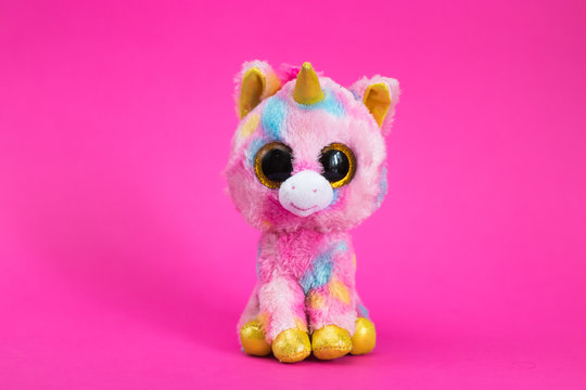 Toy Pink Unicorn sits on a pink background