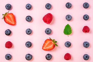 Pattern of berries on pink background. Flat lay summer berries background. Creative minimalism. Top view