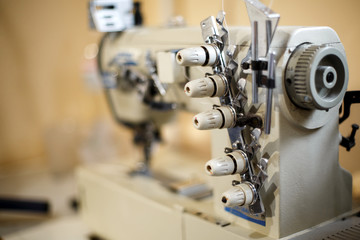 closeup details on sewing machine overlock. Workplace seamstress.Tailoring industry