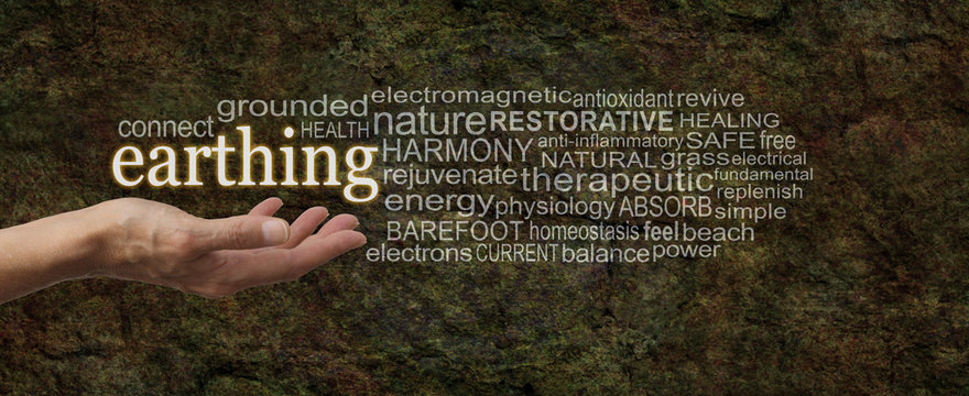 Earthing Word Cloud - female hand palm up outstretched with the word EARTHING floating above surrounded by a relevant word cloud on a dark brown earthy rustic stone effect background