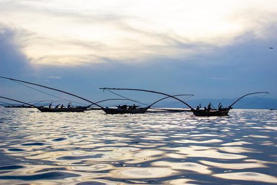 Fishing Canoes on Lake Kivu, Rwanda, with the Sun's Reflection on Water