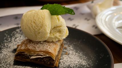 Typical Lebanese cake baklava with vanilla ice cream